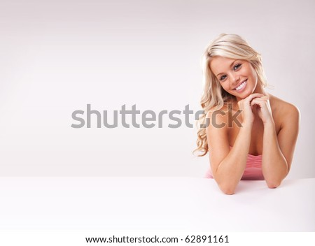 Portrait of beautiful blonde girl at table