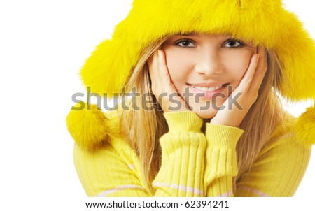 portrait of beautiful blonde girl in yellow furry cap with ear flaps