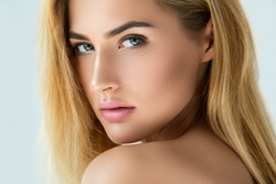Portrait of beautiful blonde girl with beautiful eyes