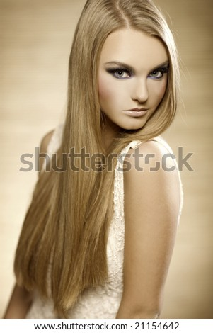 portrait of beautiful blonde girl with long hair