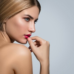Portrait of beautiful blonde girl with red lips