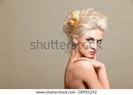 Portrait of beautiful blonde on the white background