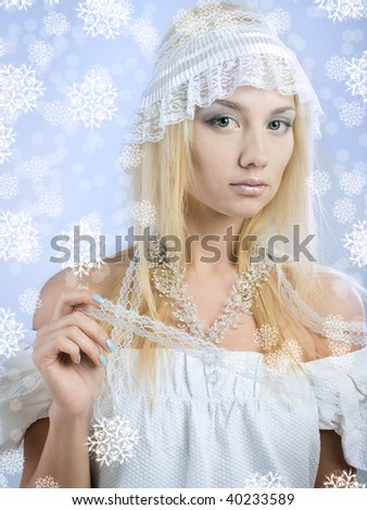 portrait of beautiful blonde with drawn snowflakes