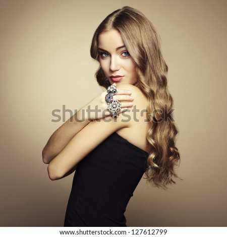 Portrait of beautiful blonde woman in black dress. Fashion photo