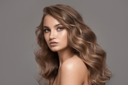 Portrait of beautiful blonde woman. Volume hairstyle.