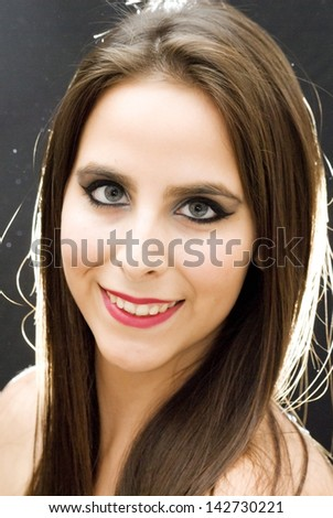 Portrait of beautiful blue-eyed girl with back lighting
