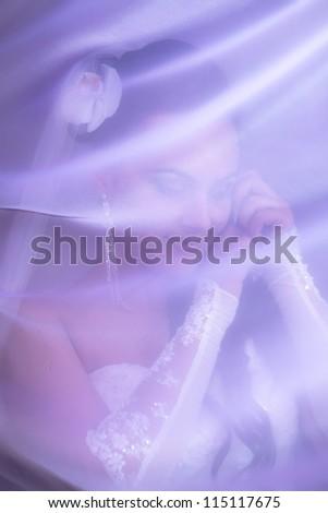 Portrait of beautiful bride near a window