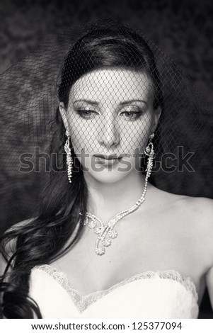 Portrait of beautiful bride. Wedding dress. Wedding decoration. Black and white