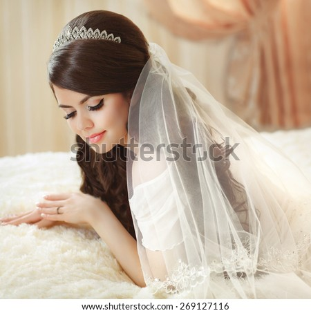 Portrait Of Beautiful Bride With Fashion Veil Posing On