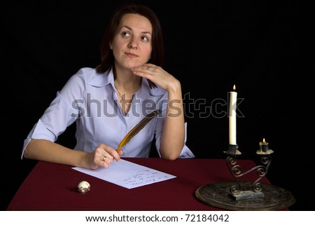 portrait of beautiful brown-haired girl writing work