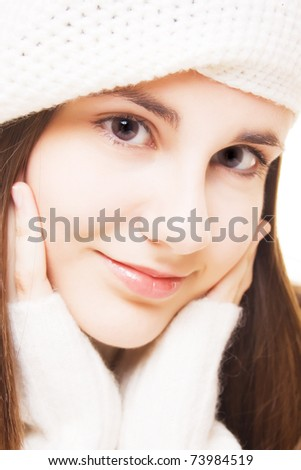 Portrait of beautiful brunette girl in white winter outfit