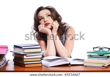 portrait of beautiful brunette student girl sitting with books and dreaming
