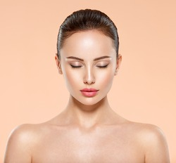 Portrait of beautiful  brunette woman with clean face, closed eyes. Closeup face of young  woman with clean fresh skin. Skin care.