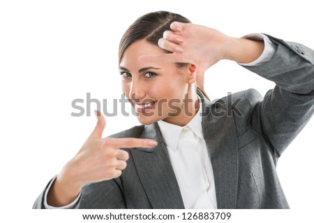 Portrait of beautiful business woman making frame gesture on white background