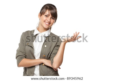 Portrait of beautiful business woman showing copy space over white background