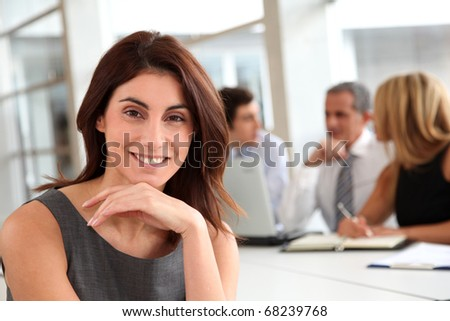 Portrait of beautiful businesswoman in work meeting