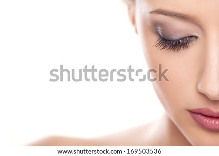portrait of beautiful calm woman on white background