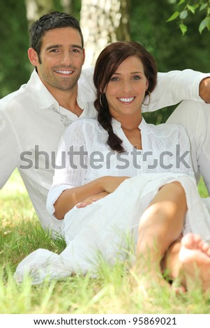 portrait of beautiful couple dressed in white