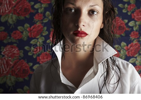 Portrait of beautiful crying girl with smeared mascara