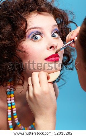 portrait of beautiful curly brunette girl make up