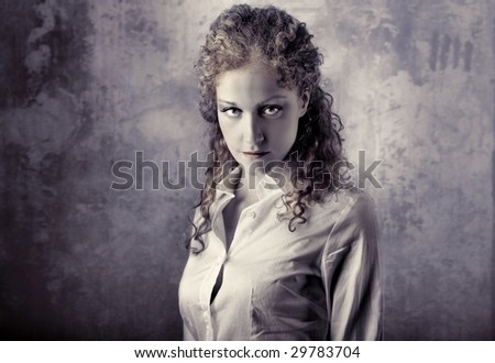 portrait of beautiful curly girl grey colored