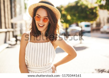 a9319667e72e Portrait of beautiful cute blond teenager model in summer hipster clothes  posing on the street background