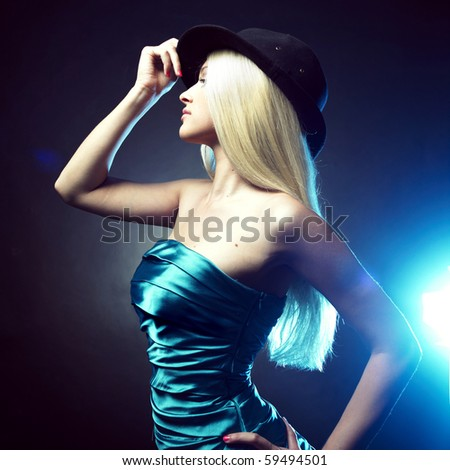 Portrait of beautiful dancing girl in hat
