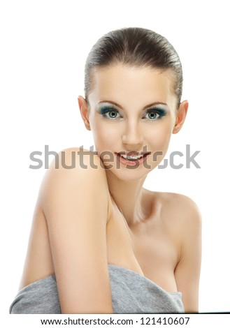Portrait of beautiful dark-haired smiling woman in gray dress, isolated on white background.