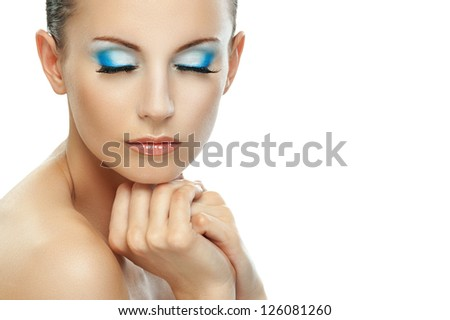 Portrait of beautiful dark-haired woman with bare shoulders and eyes closed, isolated on white background.