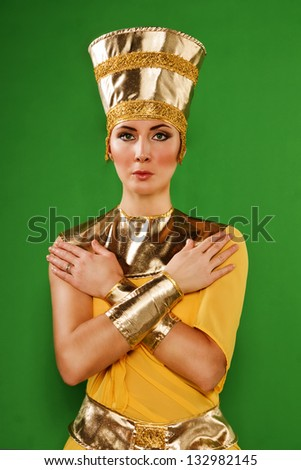 Portrait of beautiful egyptian woman in costume of the Pharaoh