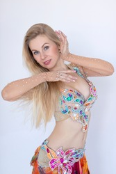 Portrait of beautiful elegance woman bellydancer with blonde hair. Belly fit dance concept.