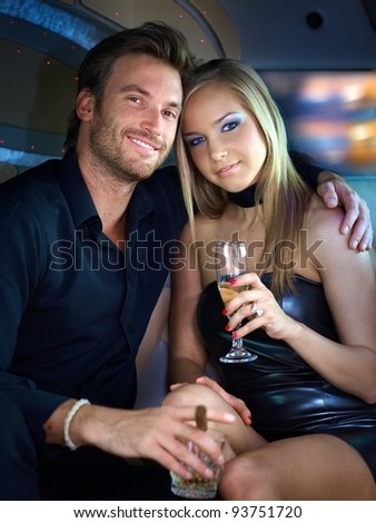 Portrait of beautiful elegant couple smiling.?