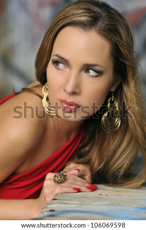 Portrait of beautiful fashion model with glamor make-up posing on exotic location