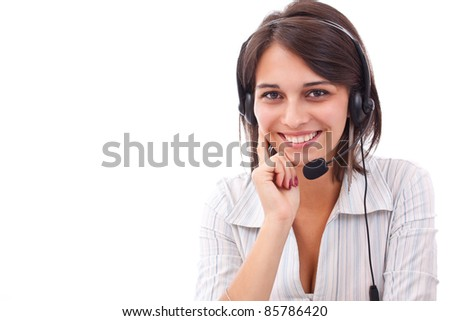 Portrait of beautiful female executive wearing headset and smiling against white