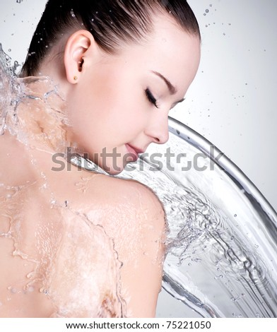 Portrait of beautiful female face with clean water - studio