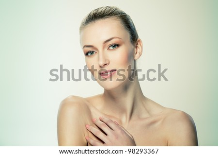 Portrait of beautiful female model on white background