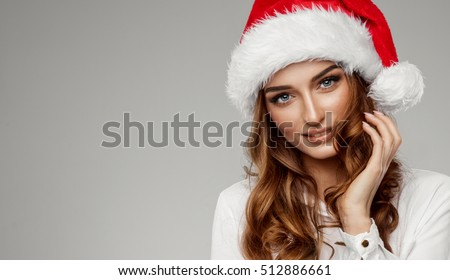 Stock Photo Portrait of beautiful female model wear santa hat