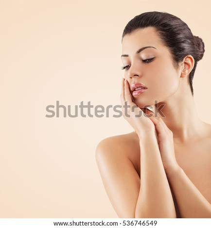 Portrait of beautiful female.She touching her face..Body care and beauty concept. #536746549