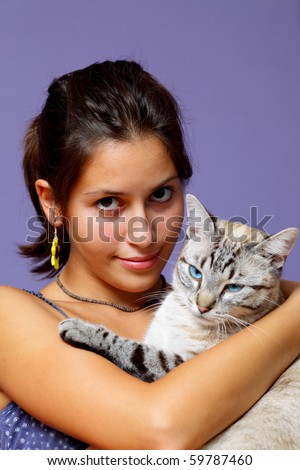 Portrait of beautiful girl and her beloved companion, cat with blue eyes