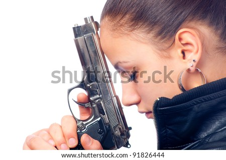 Portrait of beautiful girl in black leather jacket holding beretta gun in her hands isolated on white background. - stock photo