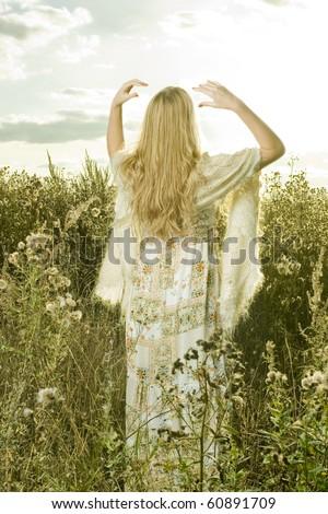 Portrait of beautiful girl in field