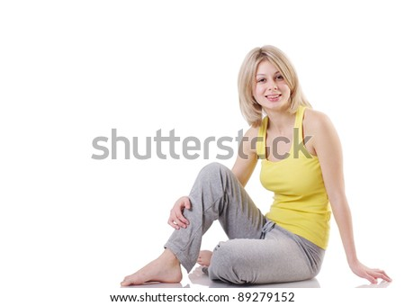 Portrait of beautiful girl relaxing after doing exercise,  isolated on white background
