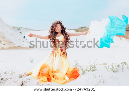 Portrait of beautiful girl sitting on a beach