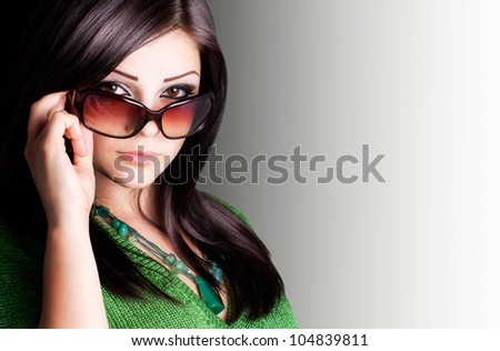 portrait of beautiful girl wearing sunglasses with copyspace