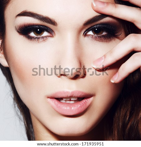 Portrait of beautiful girl with an evening make-up, close-up #171935951