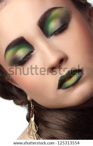 portrait of beautiful girl with art make-up