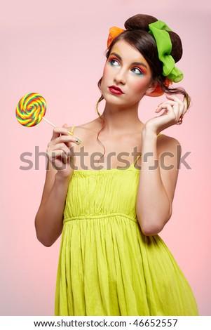 portrait of beautiful girl with big lollipop