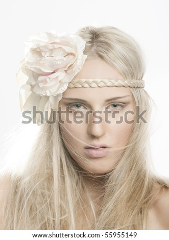 portrait of beautiful girl with flower in her hair