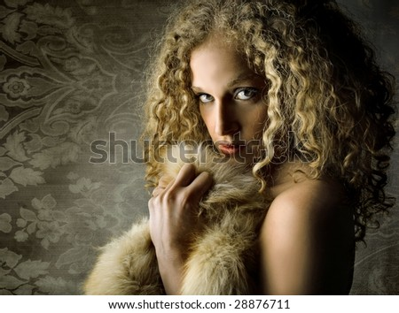 portrait of beautiful girl with fur