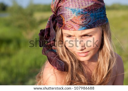 Portrait of beautiful girl with long hair, outdoor